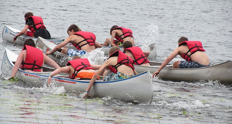 Camp Cuyuna water games in canoes